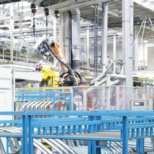 robotic arm and spare parts in a car factory